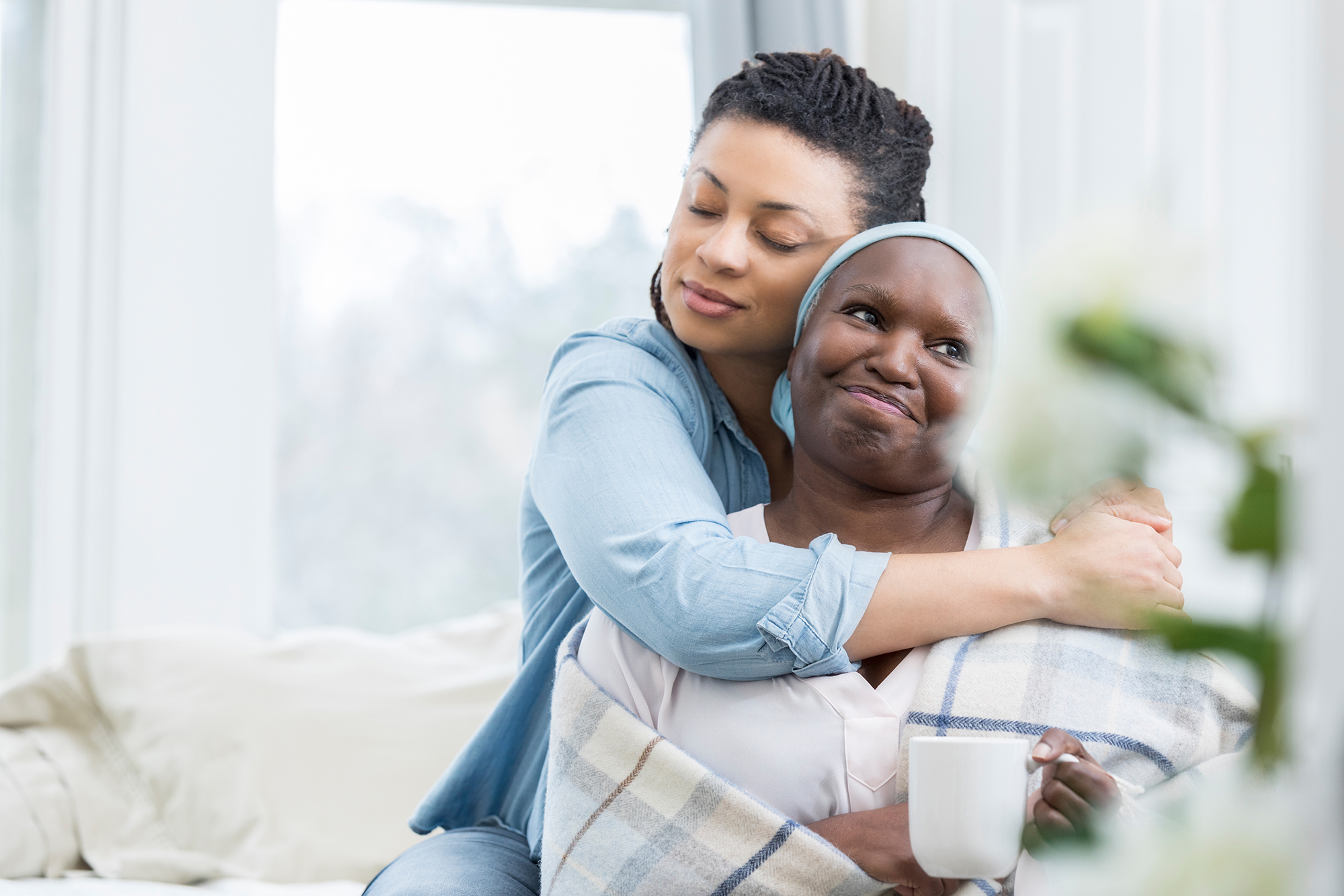 Woman embracing her mother